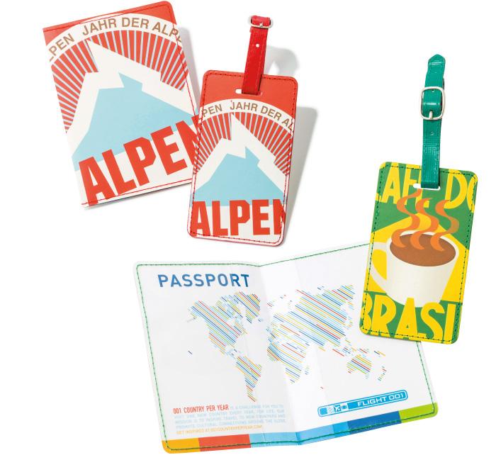 """渡航先に合わせてデザインをチョイス♪ 一つの国をモチーフにしたタグとパスポートケースのセット。カラフルなイラストに旅のテンションもUP 。写真は左がスイス、右がブラジルのデザイン。各¥2,400(フライトワン原宿店☎03・3486・7001) </div/>"""" width=""""700″ height=""""642″ class=""""alignnone size-large wp-image-42759″ /><br /> </center></div> <p><br class="""