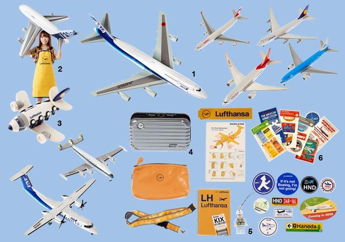 1: 昨年、退役したジャンボジェット(ANAの747)と小型機のDHC-8-Q300を1/200スケールにした模型をはじめ、漫画の資料用に集めた航空機模型。2: A380のビニールプレーンと、着用しているルフトハンザのエプロン。3: ルフトハンザのおもちゃ。4: 1stクラスのアメニティ&ノベルティ、そして購入できるルフトハンザグッズ。5: ANA×レゴストラップ。6: 空港やエアラインショップで買ったステッカーなど。