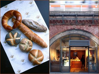 左写真: 左1列が〈ハンドカイザー〉で、プレーン、ごま、芥子の実の3種類。〈ザルツシュタンゲル〉は、岩塩をまぶしたパン、三日月形のものが〈キプフェル〉、穀物とゴマを練り込んだのが〈コーンシュピッツ〉(¥200〜250)。右写真: 再開発された万世橋の高架下にあり、上を中央線が行き交う。パンのほかにオーストリア菓子も豊富。